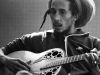 bob marley playing guitar