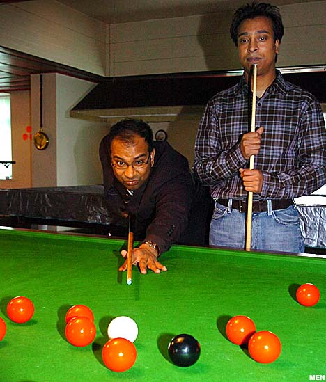 Guys playing Snooker