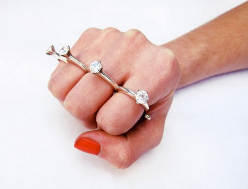 """a ring that says either """"He loves me"""" or """"I'll hurt you"""""""